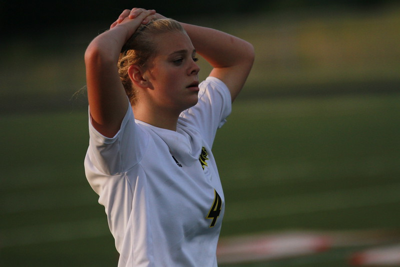 Lutheran North's Hailee Gore (4) reacts to a 2-1 loss at the hands of Flint Powers Catholic Tuesday. (MIPrepZone photo gallery by Randy Castro)