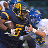 Fitzgerald's Najon Moore looks for running room as South Lake's William Townes (32) looks to make the tackle in first half.  Ray Skowronek--MIPrepZone