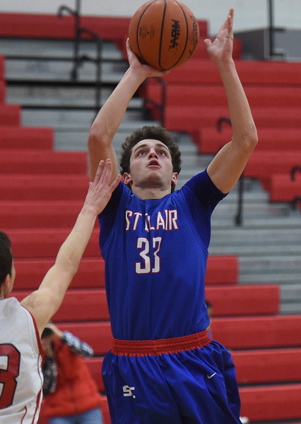 Ian Janssen (33) of  St. Clair puts up a shot during the match between St. Clair and Roseville on December  27, 2016. (MIPrepZone photo gallery by David Dalton)