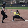 Sterling Heights first baseman Janna Pastorino reaches for a throw to retire a L'Anse Creuse North batter in the bottom of the second inning of a MAC crossover game.