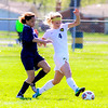 Sterling Heights Dano Kluz fights with a Fitzgerald defender to get open to take a shot. photo/Nicholas Barry