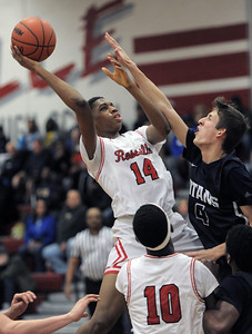 John Ukomadu (14) of Roseville puts up shot during the match between Stevenson and Roseville on January 11, 2019. THE MACOMB DAILY PHOTO GALLERY BY DAVID DALTON