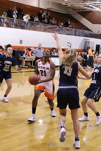 Utica's Mone' Knowles attempts a layup while defended by Stoney Creek's Emily Eckhout (33) during their non-league game at Utica on January 4, 2019. (Photo gallery by Kevin Lozon)