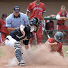 Noah Miller (15) of the University Liggett slides in to home plate during the match between University Liggett and Stevenson on June 13, 2017. (MIPrepZone photo gallery by David Dalton)