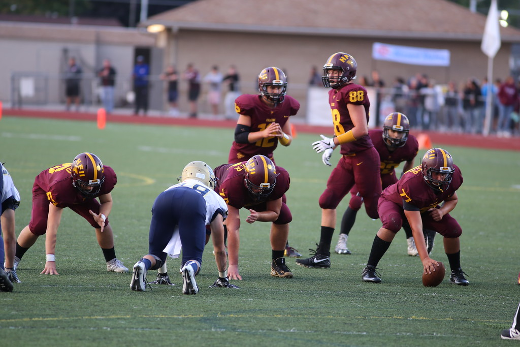 . Utica Ford\'s offense nears the end zone late in the first half, but settled for a 12-7 lead after a 33-yard field goal with 16 seconds left. (Photo by Bill Roose)