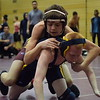 Matthew Hickey (top) of Warren-Mott tries to take control of his 103-pound match against Fitzgerald's Domonic McGinty. Hickey won by pin. (MIPrepZone photo gallery by George Pohly)
