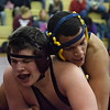 Alex Kuebler, left, of Warren-Mott wrestles Kareem Wallace of Fitzgerald at 189 pounds. Kuebler took a 7-4 decision that tied the match 21-21, and Warren-Mott went on to win 54-21. (MIPrepZone photo gallery by George Pohly)