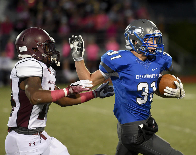 Jack Morris (31) of Eisenhower evades the Mott defensive line during the first quarter of the match between Eisenhower and Mott at Utica High School on October 14, 2016 . (MIPrepZone photo gallery by David Dalton)