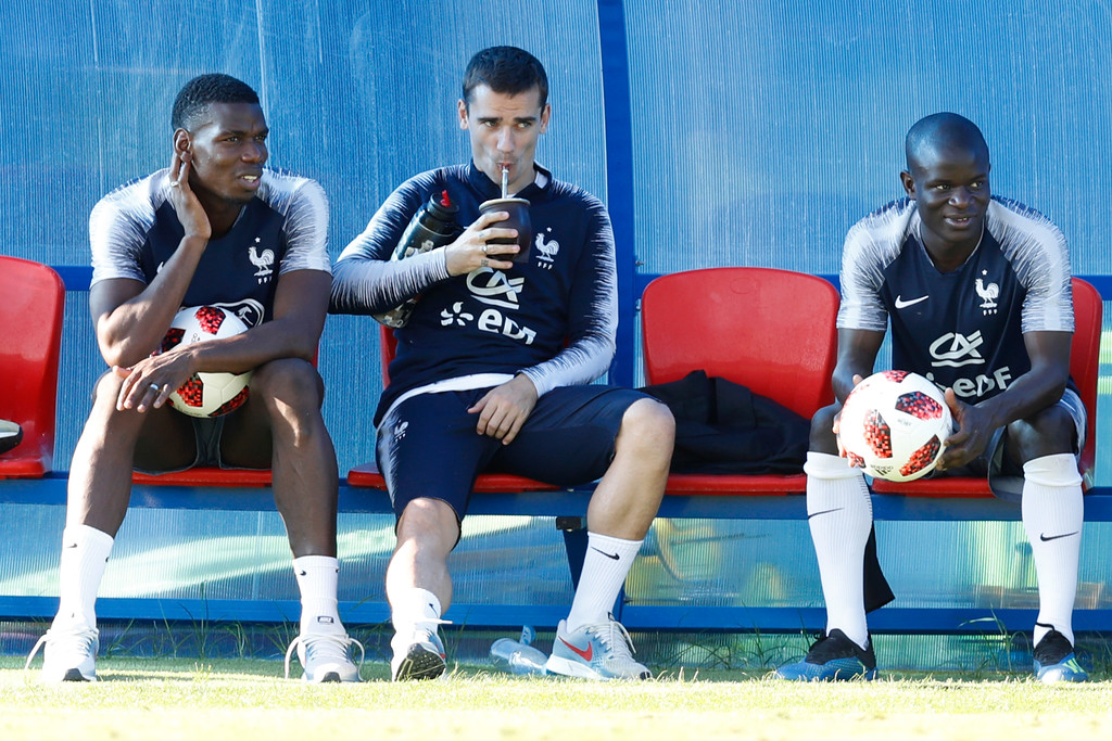 . France\'s Paul Pogba, Antoine Griezmann and Ngolo Kante seat on the bench on during a training session at the 2018 soccer World Cup in Glebovets, Russia, Thursday, July 12, 2018. (AP Photo/David Vincent)