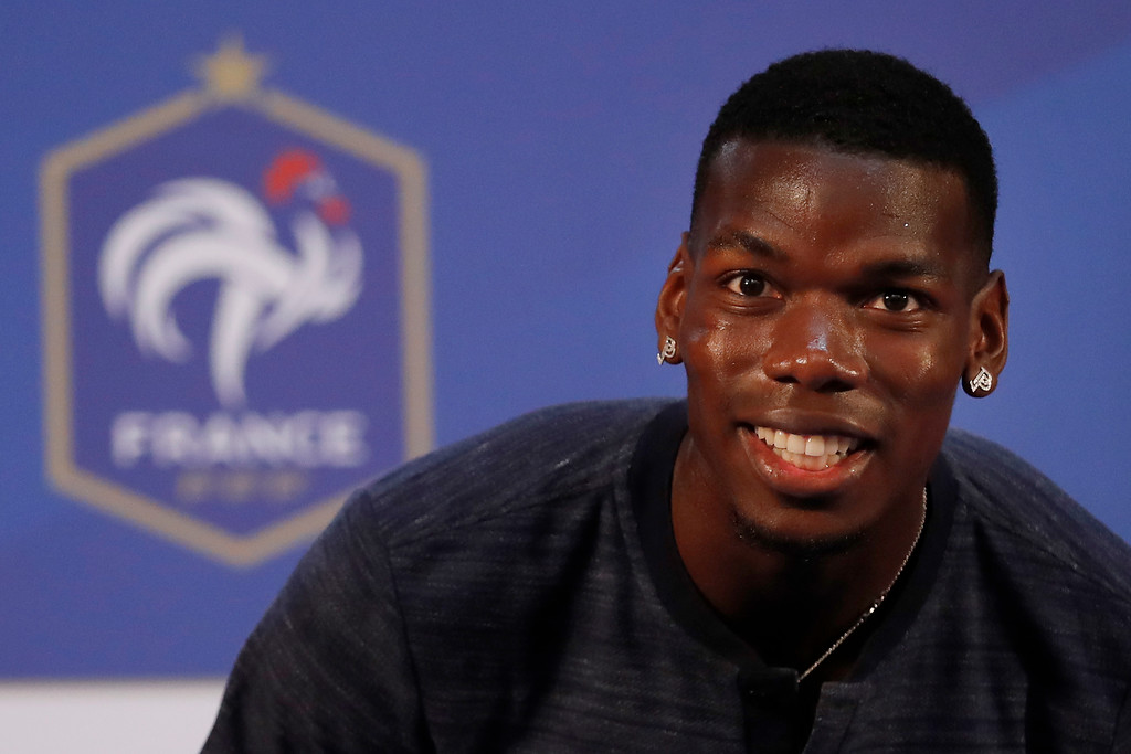 . France\'s Paul Pogba arrives at a press conference at the 2018 soccer World Cup in Istra, Russia, Thursday, July 12, 2018. (AP Photo/David Vincent)