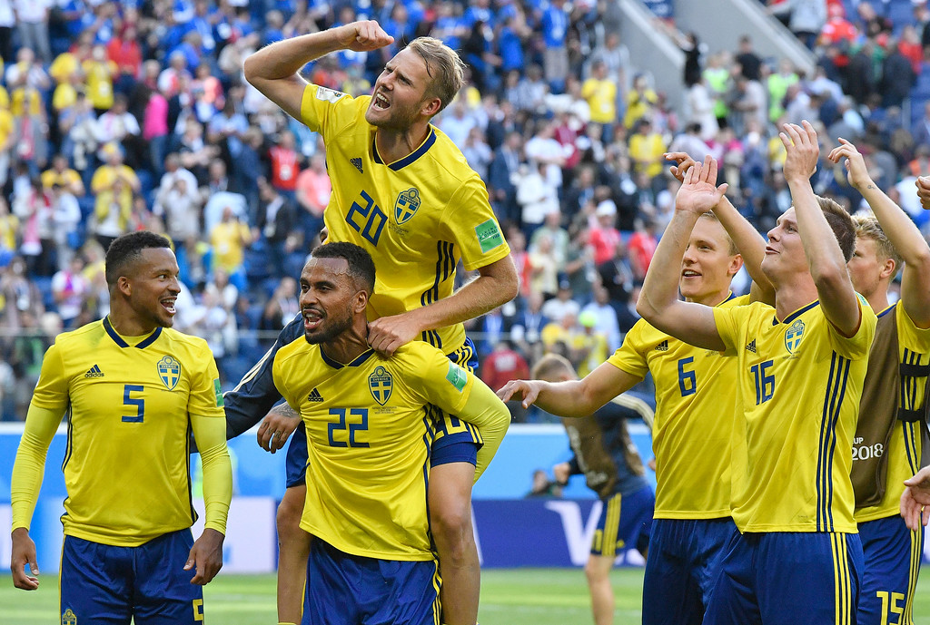 . Sweden teammates celebrate after winning the round of 16 match between Switzerland and Sweden at the 2018 soccer World Cup in the St. Petersburg Stadium, in St. Petersburg, Russia, Tuesday, July 3, 2018. (AP Photo/Martin Meissner)
