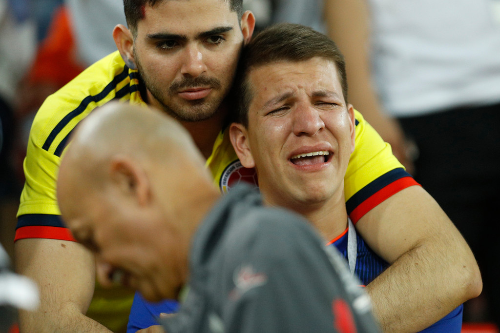 . A Colombian fan cries on the stand at the end of the round of 16 match between Colombia and England at the 2018 soccer World Cup in the Spartak Stadium, in Moscow, Russia, Tuesday, July 3, 2018. England won after a penalty shoot out. (AP Photo/Victor R. Caivano)