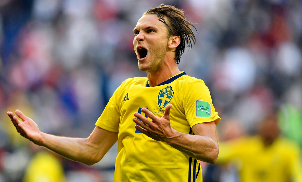 . Sweden\'s Albin Ekdal celebrates after winning the round of 16 match between Switzerland and Sweden at the 2018 soccer World Cup in the St. Petersburg Stadium, in St. Petersburg, Russia, Tuesday, July 3, 2018. (AP Photo/Martin Meissner)
