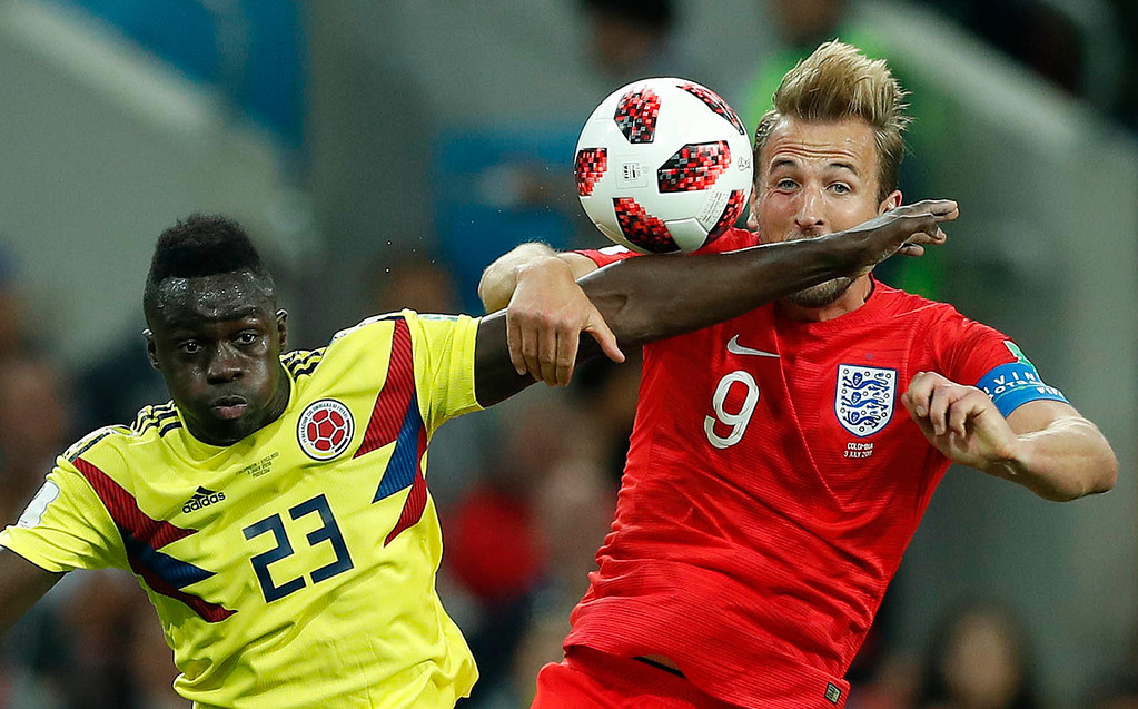 . Colombia\'s Davinson Sanchez, left, and England\'s Harry Kane challenge for the ball during the round of 16 match between Colombia and England at the 2018 soccer World Cup in the Spartak Stadium, in Moscow, Russia, Tuesday, July 3, 2018. (AP Photo/Alastair Grant)
