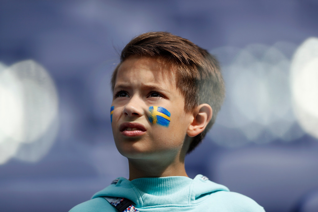 . A youngster, with his face painted with the Sweden flag, looks on as he waits for the start of the round of 16 match between Switzerland and Sweden at the 2018 soccer World Cup in the St. Petersburg Stadium, in St. Petersburg, Russia, Tuesday, July 3, 2018. (AP Photo/Darko Bandic)