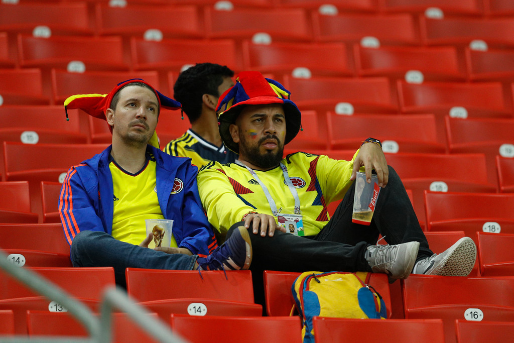 . Colombian fans sit on the stand at the end of the round of 16 match between Colombia and England at the 2018 soccer World Cup in the Spartak Stadium, in Moscow, Russia, Tuesday, July 3, 2018. England won after a penalty shoot out. (AP Photo/Victor R. Caivano)