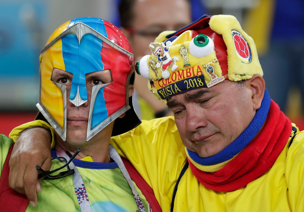 . Colombian fans reacts after England defeated Colombia in a penalty shoot out during the round of 16 match between Colombia and England at the 2018 soccer World Cup in the Spartak Stadium, in Moscow, Russia, Tuesday, July 3, 2018. (AP Photo/Ricardo Mazalan)