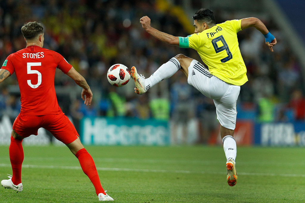 . Colombia\'s Radamel Falcao, right, lunges for the ball against England\'s John Stones during the round of 16 match between Colombia and England at the 2018 soccer World Cup in the Spartak Stadium, in Moscow, Russia, Tuesday, July 3, 2018. (AP Photo/Victor R. Caivano)