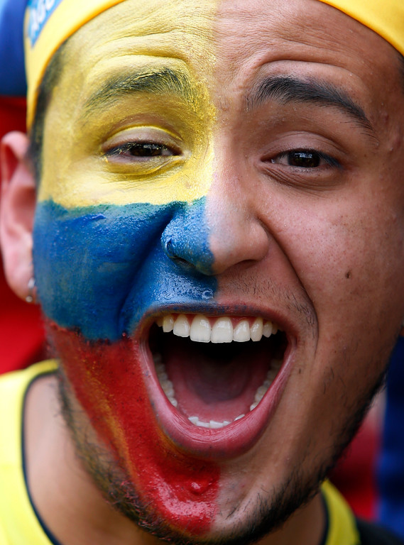 . A Colombia soccer fan watches a live telecast of the World Cup match between Colombia and England in Bogota, Colombia, Tuesday, July 3, 2018. (AP Photo/Fernando Vergara)