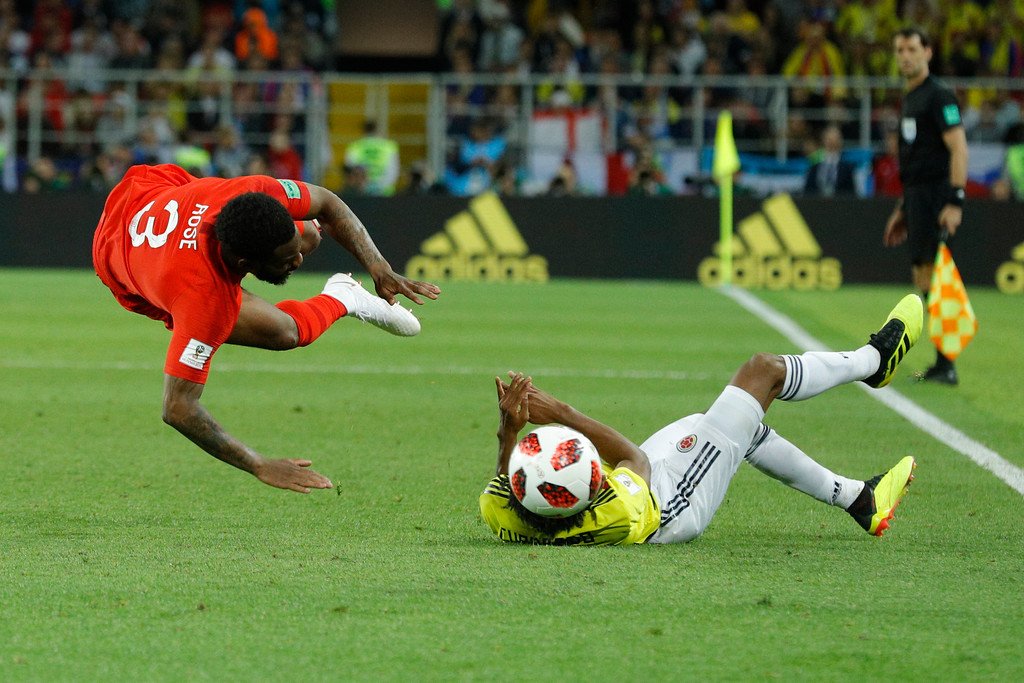 . Colombia\'s Juan Cuadrado, right, fouls England\'s Danny Rose during the round of 16 match between Colombia and England at the 2018 soccer World Cup in the Spartak Stadium, in Moscow, Russia, Tuesday, July 3, 2018. (AP Photo/Victor R. Caivano)