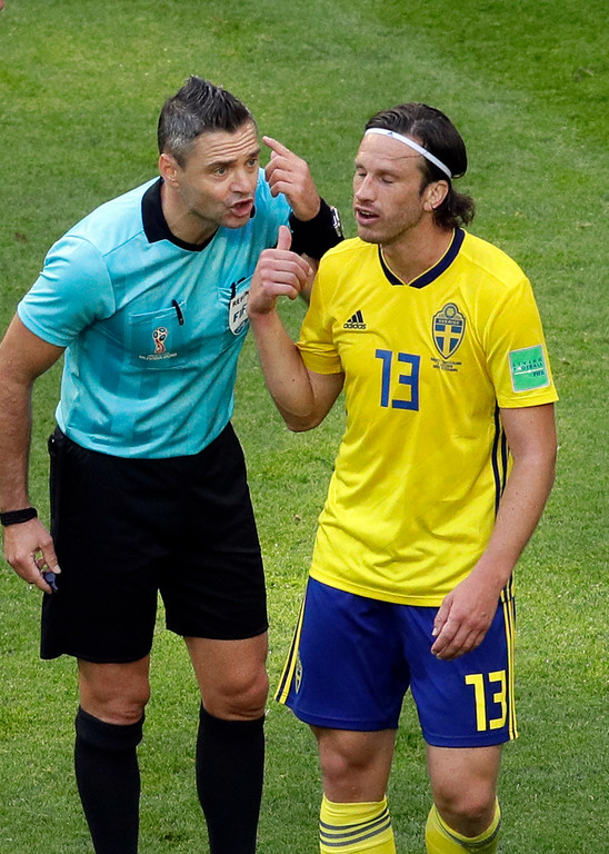 . Referee Damir Skomina from Slovenia, left, speaks with Sweden\'s Gustav Svensson during the round of 16 match between Switzerland and Sweden at the 2018 soccer World Cup in the St. Petersburg Stadium, in St. Petersburg, Russia, Tuesday, July 3, 2018. (AP Photo/Dmitri Lovetsky)