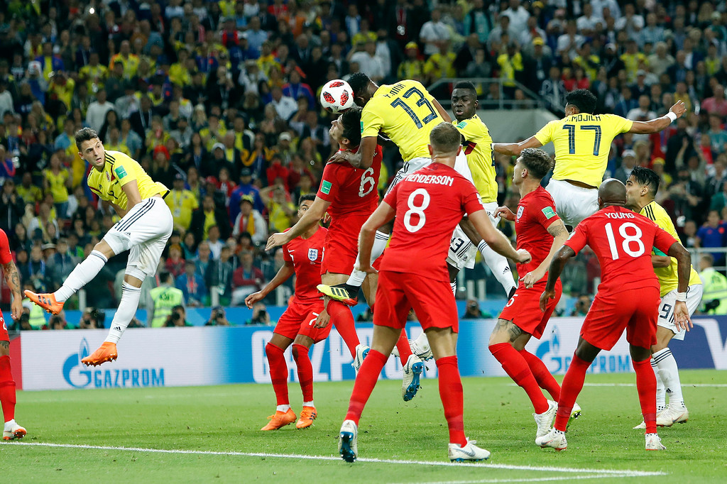 . Colombia\'s Yerry Mina, center, heads the ball to score during the round of 16 match between Colombia and England at the 2018 soccer World Cup in the Spartak Stadium, in Moscow, Russia, Tuesday, July 3, 2018. (AP Photo/Alastair Grant)
