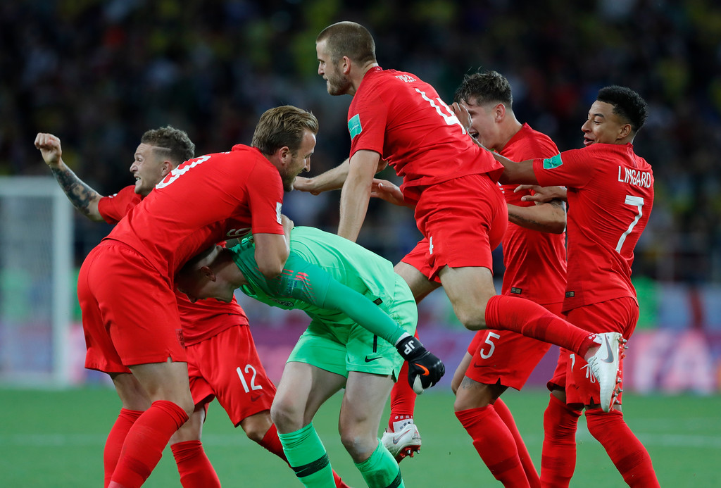 . England\'s players celebrate after defeated Colombia in a penalty shoot out during the round of 16 match between Colombia and England at the 2018 soccer World Cup in the Spartak Stadium, in Moscow, Russia, Tuesday, July 3, 2018. (AP Photo/Ricardo Mazalan)