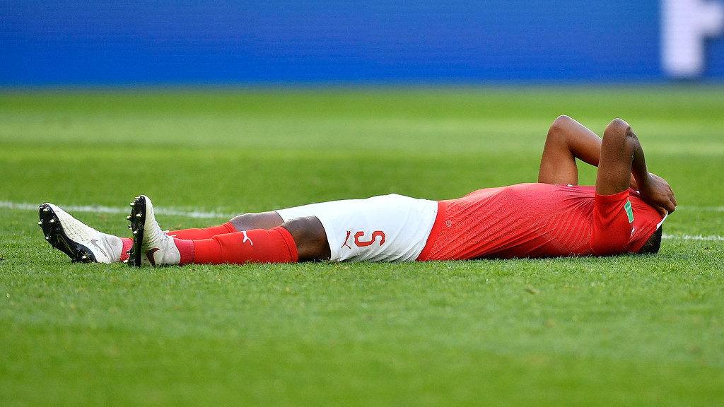 . Switzerland\'s Manuel Akanji reacts after his team lost the round of 16 match between Switzerland and Sweden at the 2018 soccer World Cup in the St. Petersburg Stadium, in St. Petersburg, Russia, Tuesday, July 3, 2018. (AP Photo/Martin Meissner)