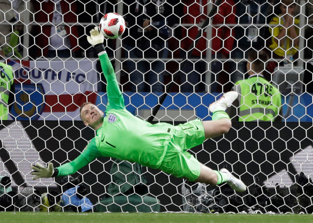 . England goalkeeper Jordan Pickford saves a penalty during the round of 16 match between Colombia and England at the 2018 soccer World Cup in the Spartak Stadium, in Moscow, Russia, Tuesday, July 3, 2018. (AP Photo/Matthias Schrader)