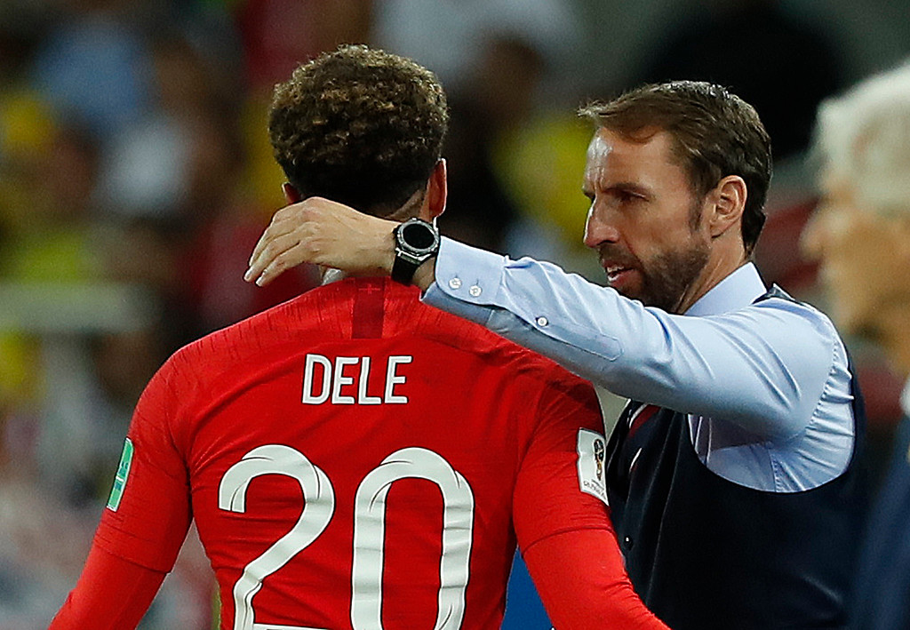 . England head coach Gareth Southgate talks to England\'s Dele Alli during the round of 16 match between Colombia and England at the 2018 soccer World Cup in the Spartak Stadium, in Moscow, Russia, Tuesday, July 3, 2018. (AP Photo/Alastair Grant)
