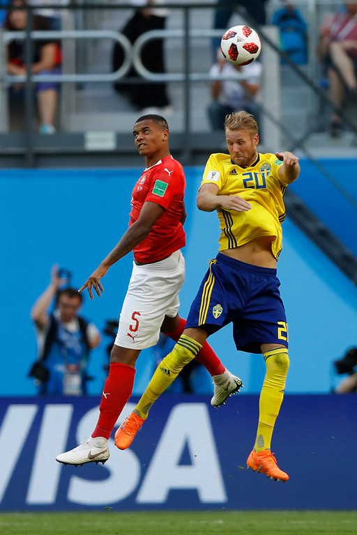 . Switzerland\'s Manuel Akanji, left, goes for a header with Sweden\'s Ola Toivonen during the round of 16 match between Switzerland and Sweden at the 2018 soccer World Cup in the St. Petersburg Stadium, in St. Petersburg, Russia, Tuesday, July 3, 2018. (AP Photo/Darko Bandic)