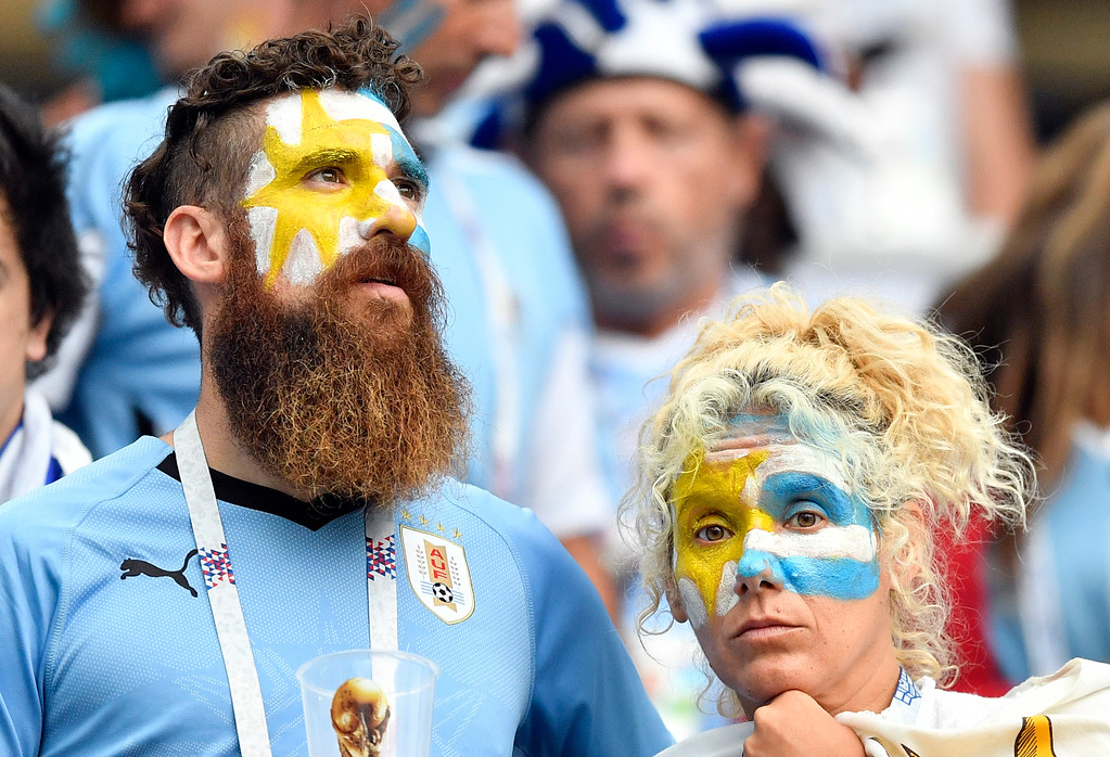 . Uruguay supporters react in dejection after the quarterfinal match between Uruguay and France at the 2018 soccer World Cup in the Nizhny Novgorod Stadium, in Nizhny Novgorod, Russia, Friday, July 6, 2018. (AP Photo/Martin Meissner)