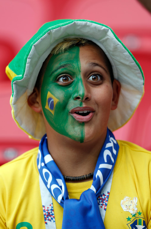 . A supporter waits for the start of the quarterfinal match between Brazil and Belgium at the 2018 soccer World Cup in the Kazan Arena, in Kazan, Russia, Friday, July 6, 2018. (AP Photo/Eduardo Verdugo)