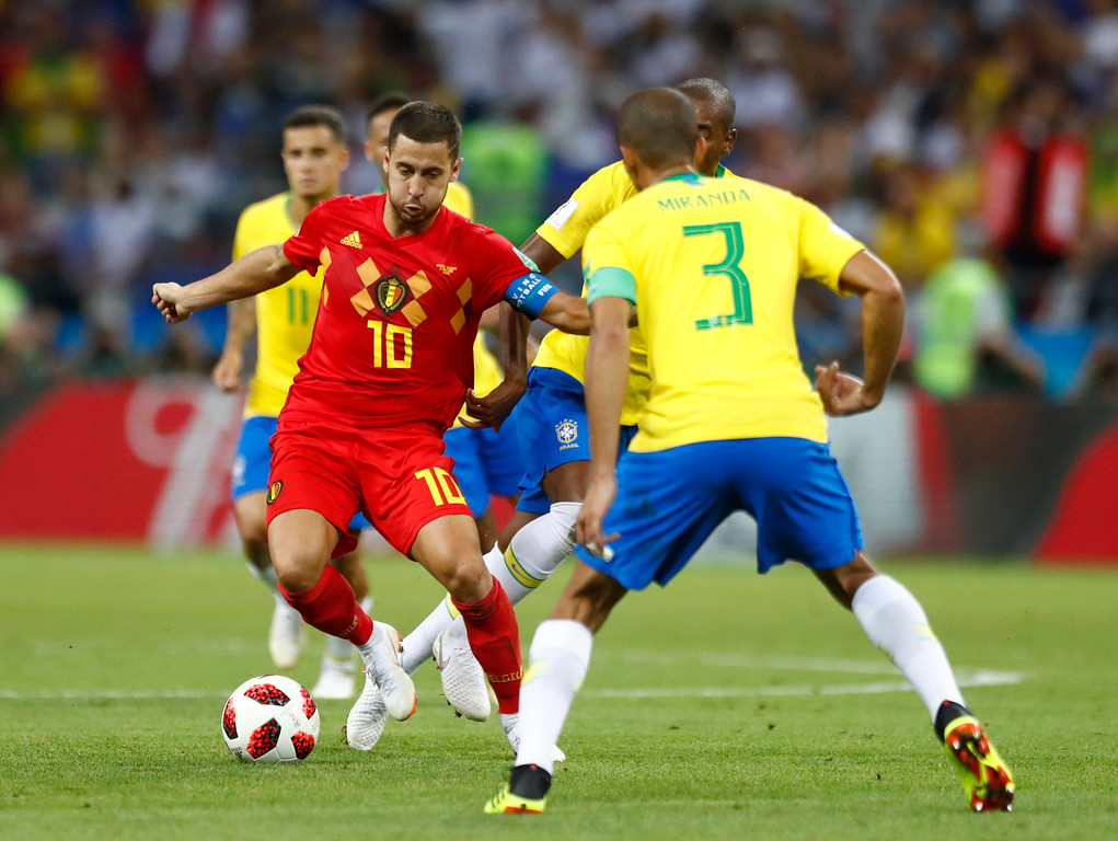 . Belgium\'s Eden Hazard, left attempts to get past Brazil\'s Miranda during the quarterfinal match between Brazil and Belgium at the 2018 soccer World Cup in the Kazan Arena, in Kazan, Russia, Friday, July 6, 2018. (AP Photo/Matthias Schrader)
