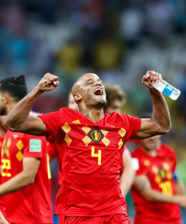 . Belgium\'s Vincent Kompany celebrates towards his teams supporters after defeating Brazil in their quarterfinal match between Brazil and Belgium at the 2018 soccer World Cup in the Kazan Arena, in Kazan, Russia, Friday, July 6, 2018. (AP Photo/Matthias Schrader)