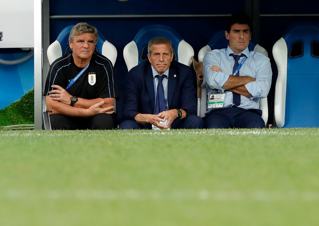. Uruguay head coach Oscar Tabarez, center, looks out from the bench during the quarterfinal match between Uruguay and France at the 2018 soccer World Cup in the Nizhny Novgorod Stadium, in Nizhny Novgorod, Russia, Friday, July 6, 2018. (AP Photo/Ricardo Mazalan)