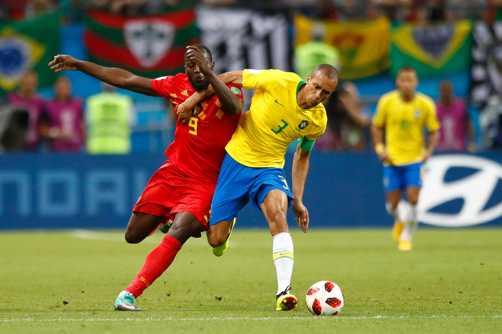 . Belgium\'s Romelu Lukaku, left, vies for the ball with Brazil\'s Miranda during the quarterfinal match between Brazil and Belgium at the 2018 soccer World Cup in the Kazan Arena, in Kazan, Russia, Friday, July 6, 2018. (AP Photo/Matthias Schrader)