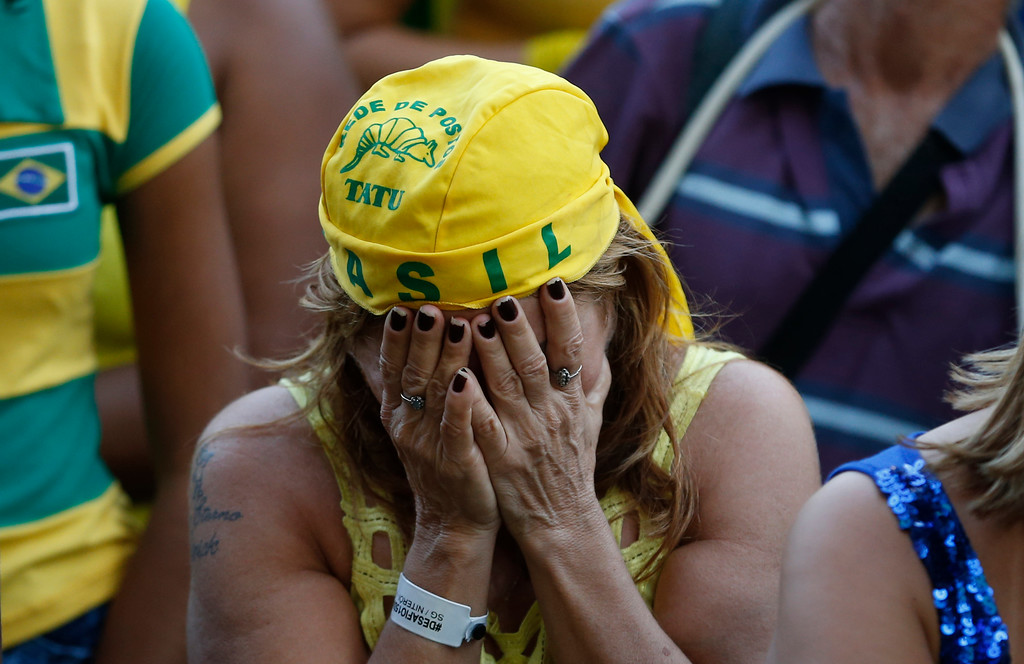 . A Brazil soccer fan cries after her team lost 2-1 to Belgium in a World Cup quarter final soccer match, in Rio de Janeiro, Brazil, Friday, July 6, 2018. (AP Photo/Silvia Izquierdo)