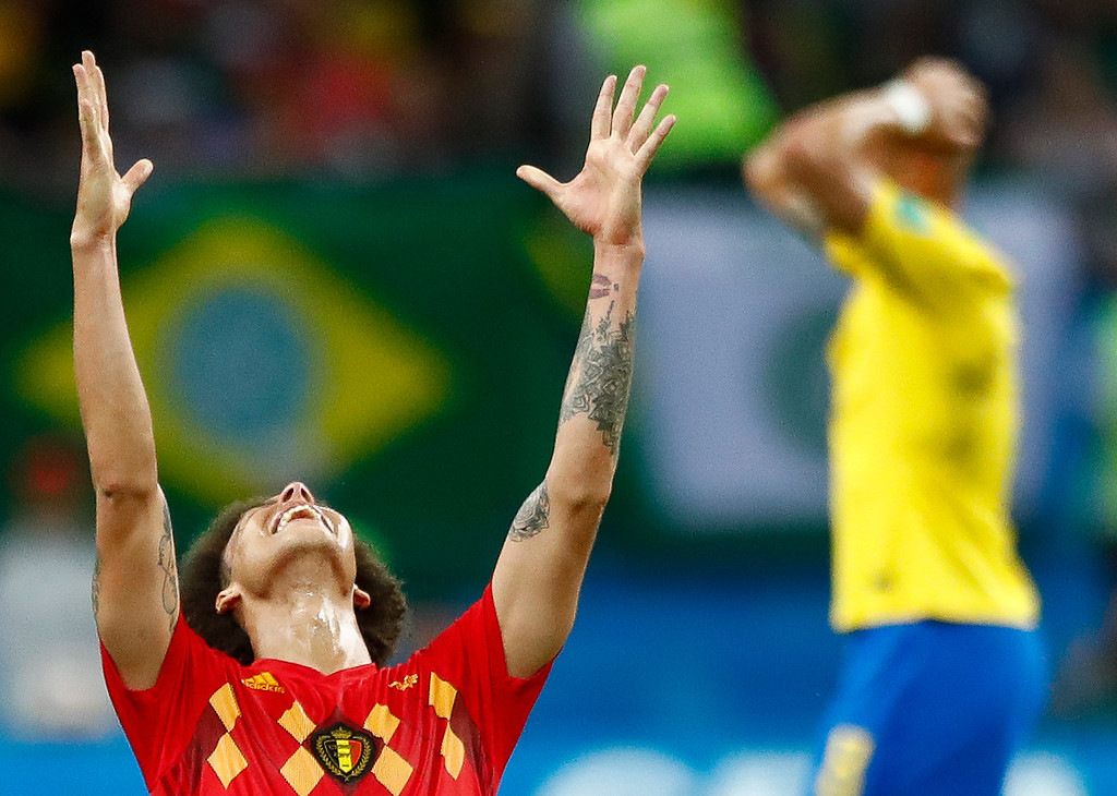 . Belgium\'s Axel Witsel, centre celebrates after the final whistle as Belgium defeat Brazil in their quarterfinal match between Brazil and Belgium at the 2018 soccer World Cup in the Kazan Arena, in Kazan, Russia, Friday, July 6, 2018. Belgium won the game 2-1. (AP Photo/Matthias Schrader)