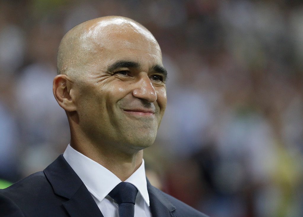 . Belgium coach Roberto Martinez smiles as he waits for the start of the quarterfinal match between Brazil and Belgium at the 2018 soccer World Cup in the Kazan Arena, in Kazan, Russia, Friday, July 6, 2018. (AP Photo/Matthias Schrader)