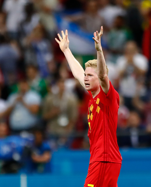 . Belgium\'s Kevin De Bruyne raises his arms as he celebrates after the end of the quarterfinal match between Brazil and Belgium at the 2018 soccer World Cup in the Kazan Arena, in Kazan, Russia, Friday, July 6, 2018. Belgium defeated brazil 2-1. (AP Photo/Matthias Schrader)