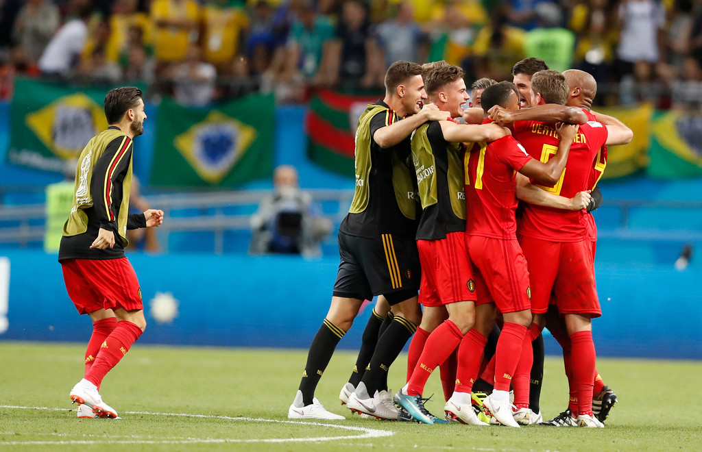 . Belgium players celebrate after they defeated Brazil in the quarterfinal match between Brazil and Belgium at the 2018 soccer World Cup in the Kazan Arena, in Kazan, Russia, Friday, July 6, 2018. (AP Photo/Eduardo Verdugo)