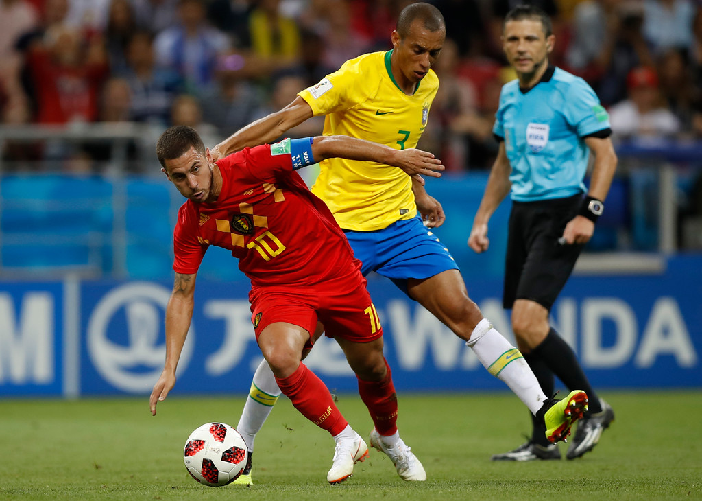 . Belgium\'s Eden Hazard, left, and Brazil\'s Miranda challenge for the ball during the quarterfinal match between Brazil and Belgium at the 2018 soccer World Cup in the Kazan Arena, in Kazan, Russia, Friday, July 6, 2018. (AP Photo/Francisco Seco)