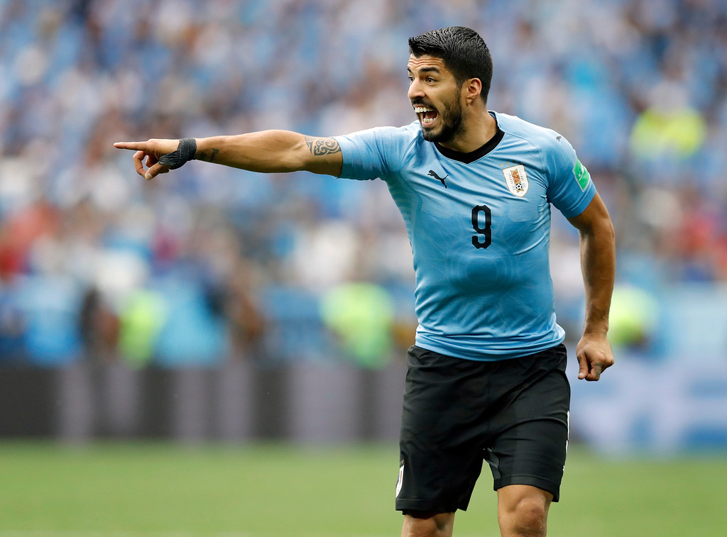 . Uruguay\'s Luis Suarez points during the quarterfinal match between Uruguay and France at the 2018 soccer World Cup in the Nizhny Novgorod Stadium, in Nizhny Novgorod, Russia, Friday, July 6, 2018. (AP Photo/David Vincent)