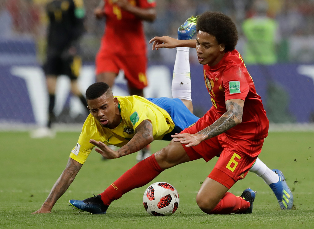 . Belgium\'s Axel Witsel, right, and Brazil\'s Gabriel Jesus clash during the quarterfinal match between Brazil and Belgium at the 2018 soccer World Cup in the Kazan Arena, in Kazan, Russia, Friday, July 6, 2018. (AP Photo/Andre Penner)