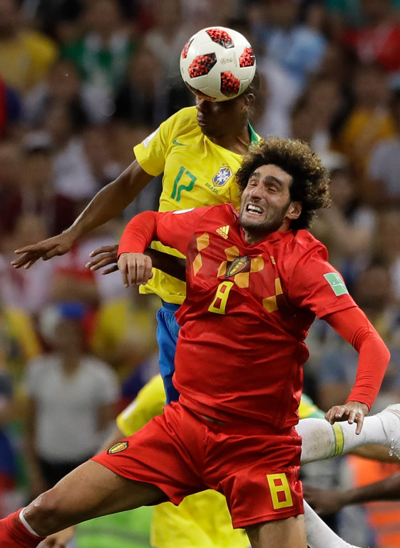 . Brazil\'s Fernandinho jumps past Belgium\'s Marouane Fellaini for a header during the quarterfinal match between Brazil and Belgium at the 2018 soccer World Cup in the Kazan Arena, in Kazan, Russia, Friday, July 6, 2018. (AP Photo/Andre Penner)