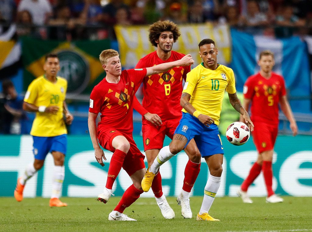 . Belgium\'s Kevin De Bruyne, left vies for the ball with Brazil\'s Neymar during the quarterfinal match between Brazil and Belgium at the 2018 soccer World Cup in the Kazan Arena, in Kazan, Russia, Friday, July 6, 2018. (AP Photo/Matthias Schrader)