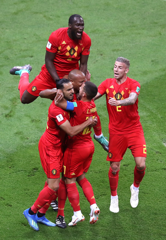 . Belgium players celebrate their first goal during the quarterfinal match between Brazil and Belgium at the 2018 soccer World Cup in the Kazan Arena, in Kazan, Russia, Friday, July 6, 2018. (AP Photo/Thanassis Stavrakis)