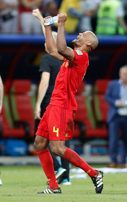 . Belgium\'s Vincent Kompany celebrates at the end of the quarterfinal match between Brazil and Belgium at the 2018 soccer World Cup in the Kazan Arena, in Kazan, Russia, Friday, July 6, 2018. (AP Photo/Eduardo Verdugo)
