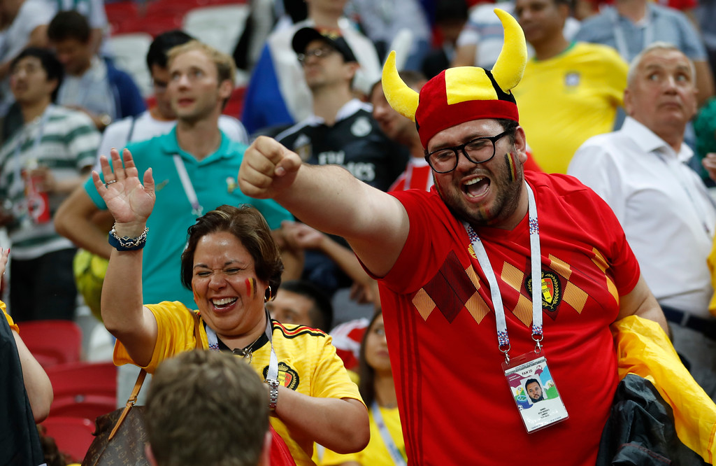 . Belgian fans celebrate after their team won the quarterfinal match between Brazil and Belgium at the 2018 soccer World Cup in the Kazan Arena, in Kazan, Russia, Friday, July 6, 2018. (AP Photo/Francisco Seco)